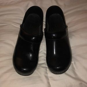 Dansko Clogs. Black patent leather.